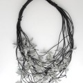 Felix Gill | get Laid! | anodized aluminium / 925 silver / pvc cord | lei / neck piece | October 2011 |